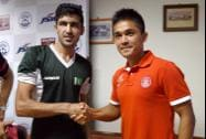 Indian football captain Sunil Chettri greets his counterpart from Pakistan Kaleemulla