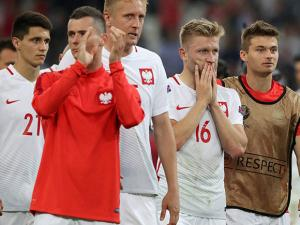 Poland's Jakub Blaszczykowski, 2nd right, and his teammates leave the pitch at the end of the Euro 2016 quarterfinal