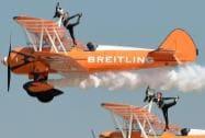 UK's AeroSuperBatics team Breitling Wingwalkers performs during the inauguration of the AERO INDIA 2015