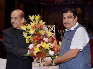 Former Lok Sabha Speaker Manohar Joshi greets Union Minister Nitin Gadkari