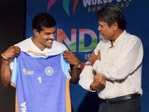 Kapil Dev along with Kabaddi player Dharmaraj Cheralathan