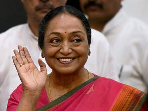 Presidential Candidate Meira Kumar greets the media as she arrives for the press conference