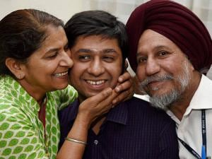 Jasmeet Singh Sandhu who got the third rank in the Civil Services Exams 2015, with his parents at their residence in New Delhi