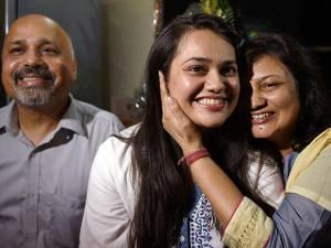 Tina Dabi who got the First rank in the Civil Services Exams 2015 with her parents at their residence in New Delhi