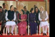 Prime Minister Narendra Modi speaks to  his Vietnam's Tran Thanh Kiem, wife of Vietnamese PM Nguyen Tan Dung