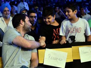 Rahul Gandhi greets his young fans at the WBO Asia Pacific Middleweight Championship