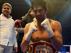 Vijender Singh celebrates  after beating Australia's  Kerry Hope