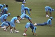 Indian teammates stretch during a training session for their Cricket World Cup semifinal