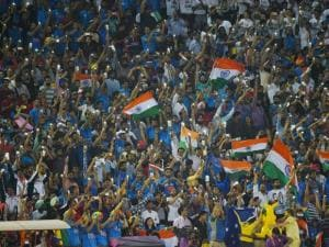 Cricket fans cheering during World Cup T20 match between India vs Australia at PCA Cricket Stadium, Mohali