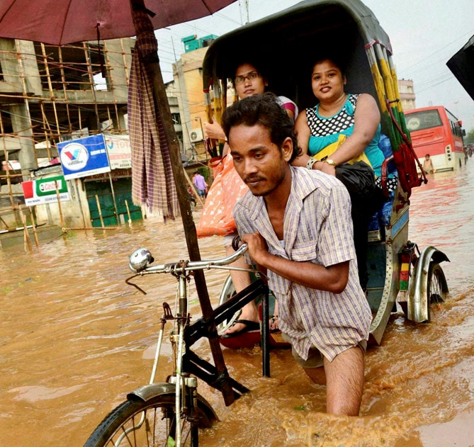 rickshaw, puller, wades, through, waterlogged, road, heavy, downpour, Guwahati