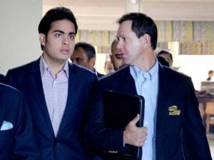 Mumbai Indians owner Akash Ambani (L) and former Australian cricketer and Mumbai Indians coach Ricky Ponting arrive to participate in the IPL players auction