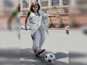 BJP MP Rupa Ganguly kicks the ball after the launch of an initiative by the Sports Ministry