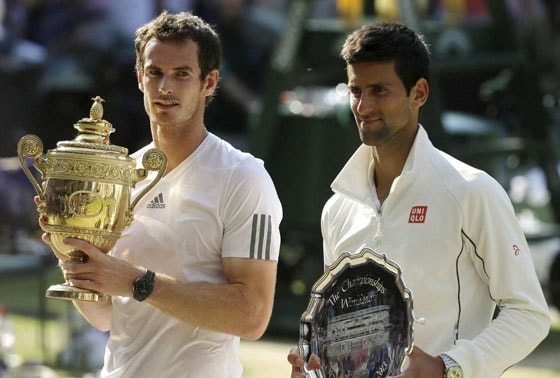 Andy Murray of Britain, left and Novak Djokovic of Serbia pose with their winner and runner up trophies at the All England Lawn Tennis Championships in Wimbledon, London