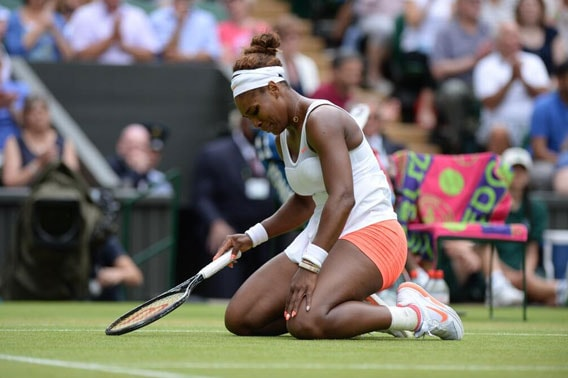 Serena Williams reacts after losing to Sabine Lisicki in the fourth round  at the All England Lawn Tennis Championships in Wimbledon, London