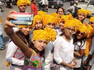 Girls, wearing turban, taking selfie as they celebrate Women's Day in Nagpur