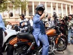 Ranjeet Ranjan, Lok Sabha MP from Supaul (Bihar), rides a Harley Davidson bike at Parliament in New Delhi on International Women's Day