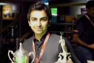 Pankaj Advani poses for photographs after winning the World Billiards Championship
