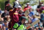 West Indies's Denesh Ramdin, back, throws the ball up after catching out Ireland's William Porterfield