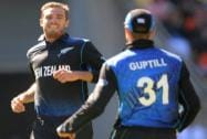 Tim Southee with Martin Guptill