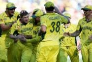 Australia's James Faulkner is congratulated by his teammates after taking the wicket of New Zealand's Corey Anderson