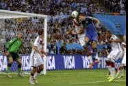 Argentina's Sergio Aguero and Germany's Miroslav Klose go for a header during the World Cup final soccer