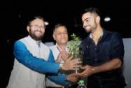 Prakash Javadekar presenting a sapling to the Captain of Indian Test Cricket Team, Virat Kohli