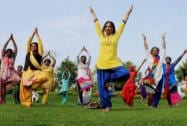 School children participate in a full dress rehearsal for International Yoga Day