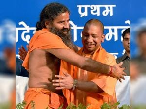 Yogi Aditiyanath greets Swami Ramdev during Yog Mahotsav in Lucknow