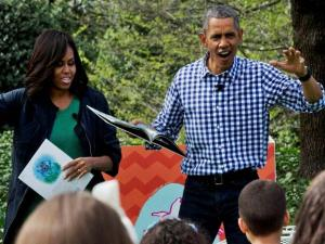 First lady Michelle Obama and President Barack get up to demonstrate the wild rumpus part of the book,  Where The Wild Things Are, as the president read the book to children during the White House E