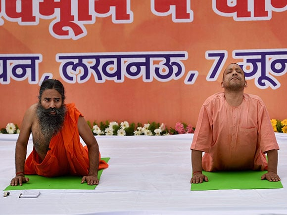 Yoga Day, Ramdev Baba, Yogi Adityanath, International Yoga Day, yoga practice, Yoga Guru, Lucknow