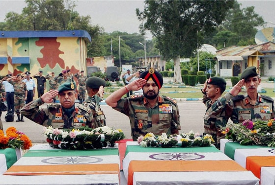 Chief of Army Staff General Bikram Singh pay tributes to five of their slain soldiers  at a wreath laying ceremony in Jammu Airport on Wednesday. The soldiers were killed in an attack by the the Pakistani troops