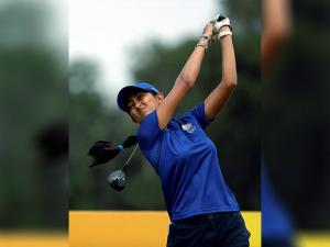 Aditi Ashok of India, hits her tee shot on the 3rd hole during the second round of the women's golf event at the 2016 Summer Olympics