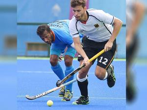 India's Sunil and German player in action  during Men's hockey event at Rio Olympics 2016