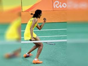India's PV Sindhu  celebrate after defeating Japan's Nozomi Okuhara