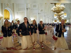 Russia's members of the national Olympic team walk after their meeting with Russian President Vladimir Putin