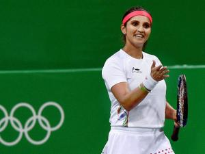 India's Sania Mirza in action during her mixed doubles match along with partner Rohan Bopanna