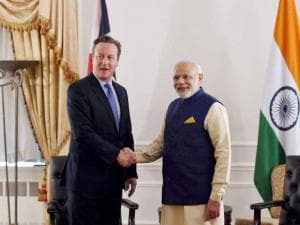 PM Modi shakes hands with British PM David Cameron
