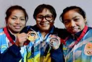 India's gold medalists celebrate with their coach