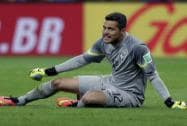 Brazil's goalkeeper sits on the pitch during the match