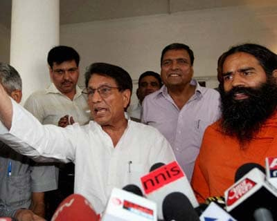 <p>RLD chief Ajit Singh and Yog Guru Baba Ramdev after a meeting in New Delhi on Thursday.</p>
