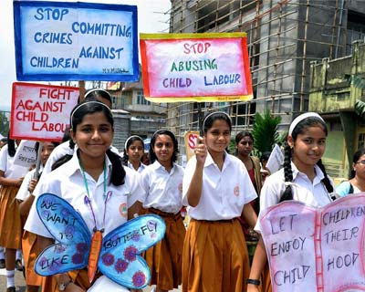 <p>School children participate in an awareness rally against child labour ahead of the International Child Labour Day in Guwahati on Friday.</p>