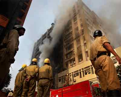 Fire fighters douse a major fire in Himalaya Building