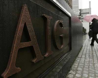 AIG posts huge 4th-quarter profit on tax benefit