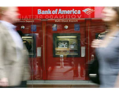 """A Bank of America branch is pictured in New York in this May 2009 file photo.  The bank has announced plans to start forgiving mortgage loan principal for troubled homeowners who owe more than 120 per cent of their home&#39;s value or are battling ever-expanding """"negative amortisation"""" loans. According to a summary of the program, Bank of America pledged to offer an """"earned principal forgiveness"""" of up to 30 per cent in two stages. The lender will first offer an interest-free forbearance of principal that the homeowner can turn into forgiven principal annually over five years, provided they stay current on their payments. The forgiveness can allow a homeowner to bring the loan value back down to 100 per cent of the home&#39;s value over five years, according to the plan, confirmed by sources close to the matter. <P> <b>Courtesy: Reuters</b> </P>"""