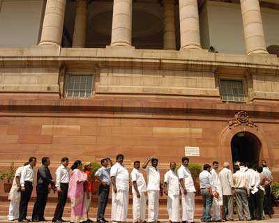 Members of the public line up outside Parliament house prior to the Budget proceedings