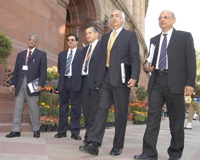 CBDT Chairman S S N Murthy, CBEC Chairman P C Jha, Revenue Secretary P V Bhide, Economics Affairs Secretary Ashok Chawla and Finance Secretary Arun Ramanathan outside the Parliament <P> <b>Image by Sanjay K Sharma</b> <P>