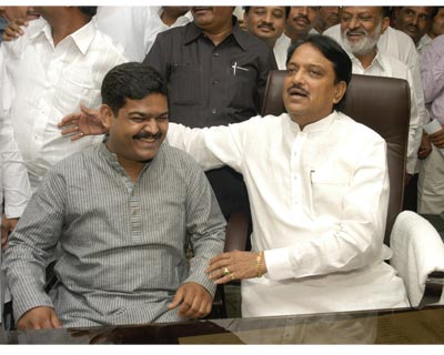 Vilasrao Deshmukh assumed charge as Heavy Industries Minister and (left) Pratik Prakashbapu Patil as Minister of State