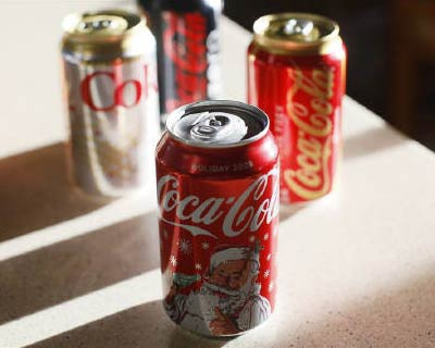 Coca-Cola: Coca-Cola products are displayed on a kitchen counter in Golden, Colorado, December 17, 2009. The aerated drink giant&#39;s Indian arm has been asked to pay $47 million compensation for causing environmental damage at its bottling plant in Palakkad, Kerala. A state government panel said the company&#39;s subsidiary, Hindustan Coca-Cola Beverages Pvt Ltd (HCBPL), was responsible for depleting groundwater and dumping toxic waste around the plant between 1999 and 2004.