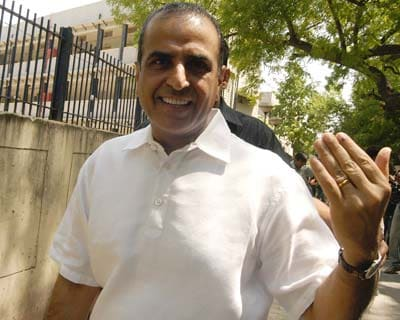 Sunil Bharti Mittal shows off the election mark on his hand outside the polling station at Aurangzeb lane, New Delhi