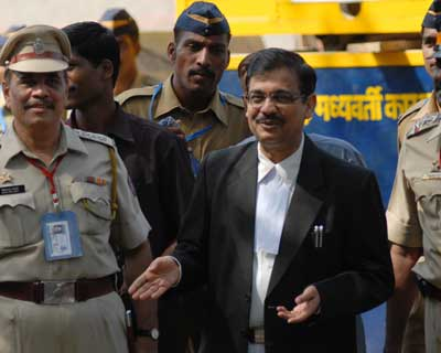 Ujjwal Nikam with Police personnel outside Arthur Road jail in Mumbai on Wednesday, April 15.